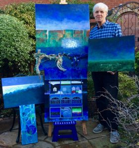 Dave Allen with paintings